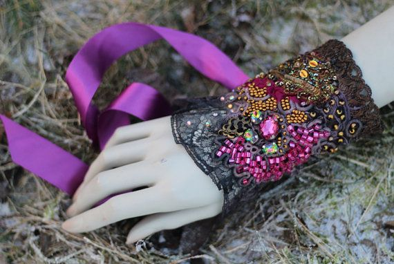 Romantic bold wrist wrap or cuff is made of antique and vintage textiles and trims. the base is vintage brocade with metallic bronze pattern and