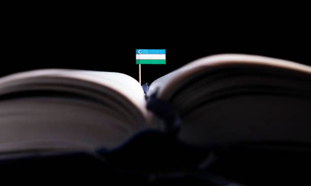 uzbekistan flag in the middle of the book knowledge and education