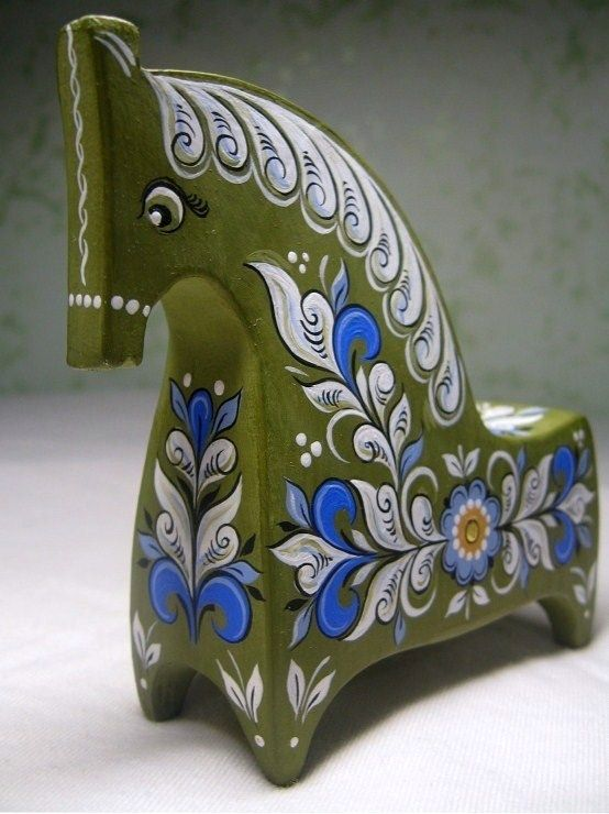 A handmade wooden horse with folk Northern painting is one of the traditional Russian toys. #folk #art #Russian #toys