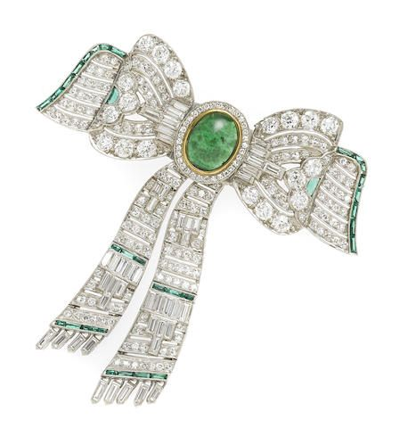 A diamond, nephrite and green stone articulated bow brooch