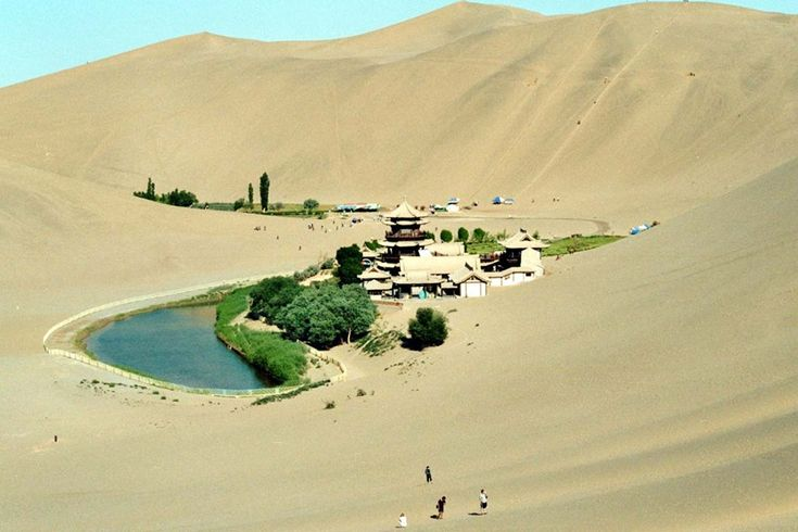 Crescent Lake in Dunhuang called as Yueyaquan which is a crescent shaped lake in an oasis. It is located 6 km south of the city of Dunhuang in Gansu Province, China. Surrounding deserts and lake are very popular with tourists, who are offered camel and 4×4 rides. In 1960 the depth of the lake was 7.5 meters [24.61 feet]; later it has declined to 1.3 meters [4.27 feet] by 1990. In 2006 with the help of local government they started to fill the lake and restore its depth.