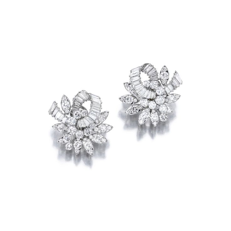 Pair of Diamond Ear Clips, Massoni. Of cluster design, set with circular-cut, tapered baguette and baguette diamonds weighing approximately 9.50 carats in total, mounted in platinum, signed Massoni.