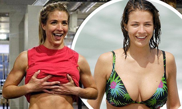 Gemma Atkinson looks delighted as she exhibits her chiselled abs