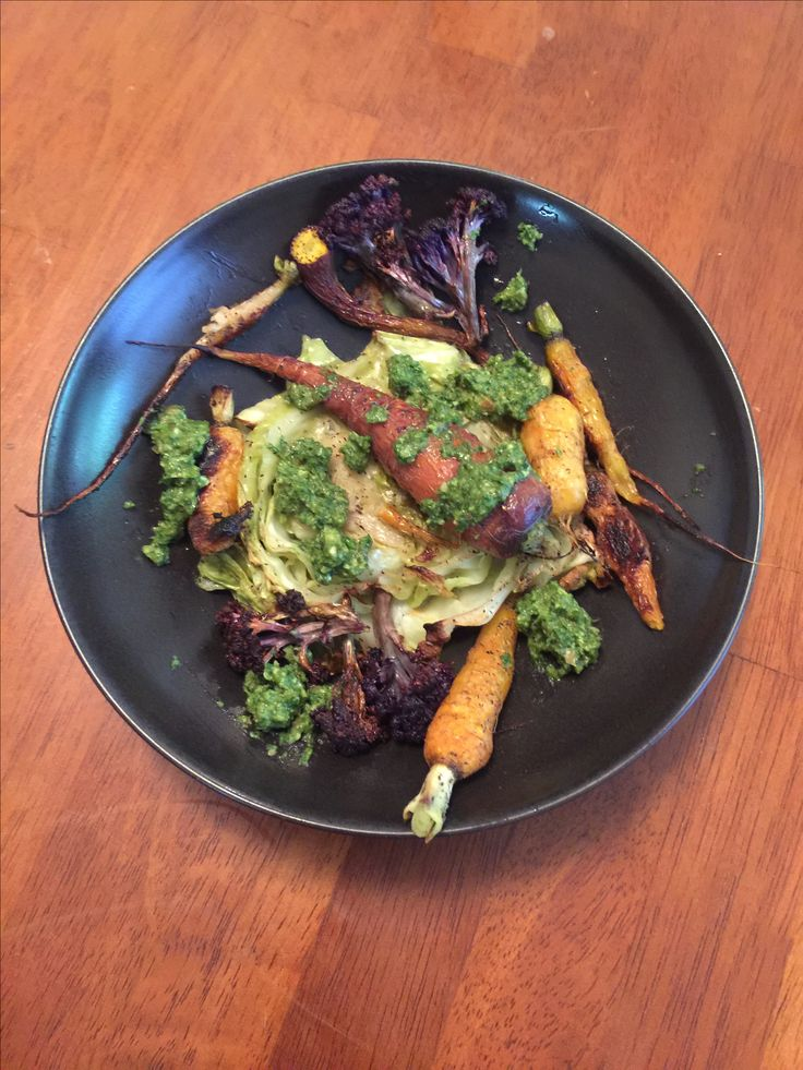 farmers market lunch. cabbage steaks, roasted rainbow carrots and purple broccoli with an almond and carrot top pesto