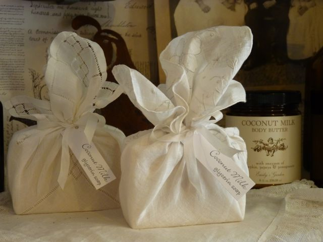 Hand made soaps wrapped in antiques hankies by Emily's Garden