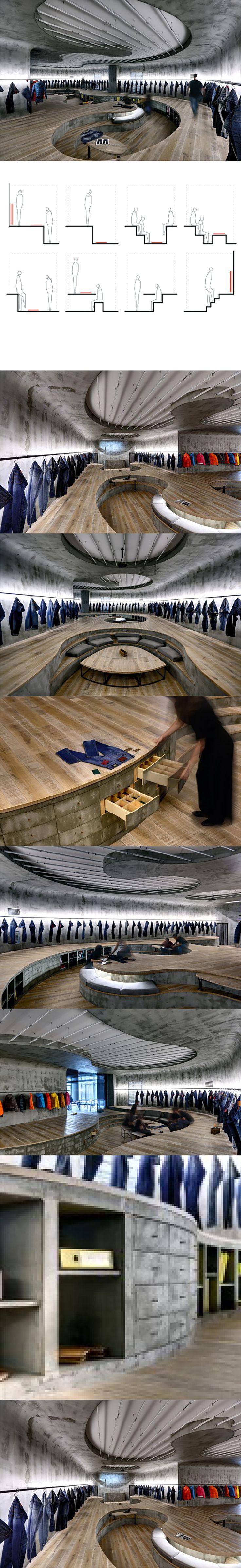 Amazing denim store delienated by a sunken floor/ curved ceiling. Vigoss R & D / Zemberek Design Office