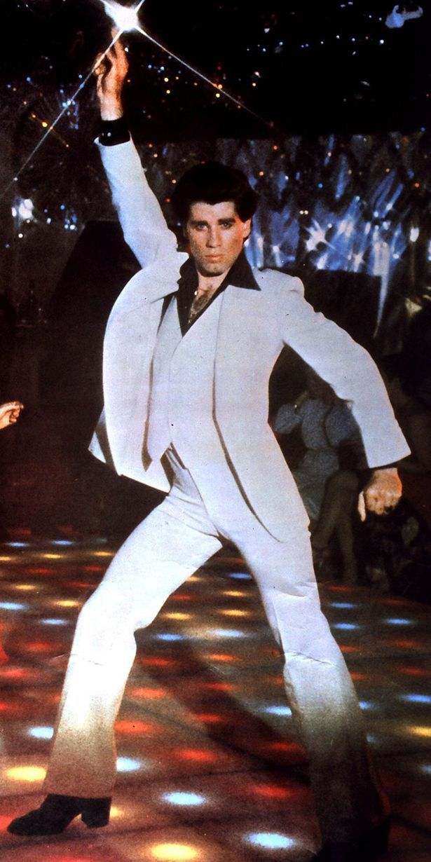 Dancefloor icon: The original John Travolta strut, 'Saturday Night Fever', 1977. S)