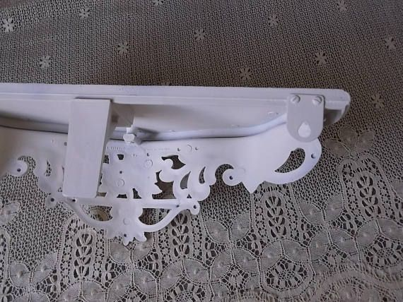 This beautiful Wall shelf has a Shabby French Country Baroque design. I have updated this vintage 80s find with heirloom white paint and distressed it for a time worn, shabby appeal! It is made of moulded hard plastic resin. It measures approximately 19.25 long x 8.5deep center to
