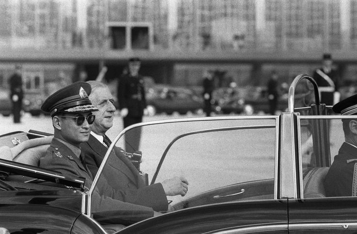 Thai King Bhumibol Adulyadej (L) riding with French President Charles de Gaulle upon his arrival at Orly airport
