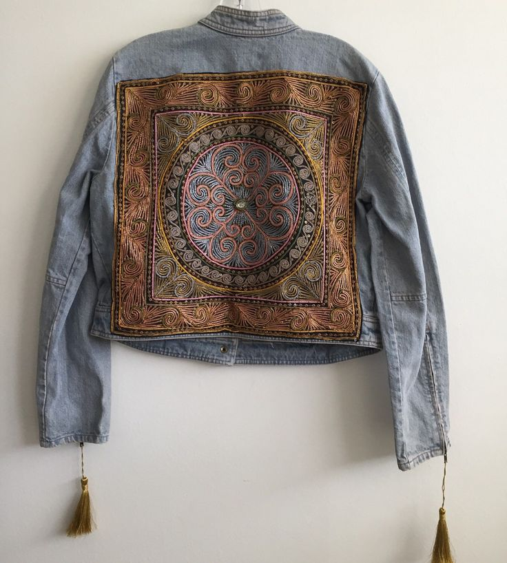 A personal favorite from my Etsy shop https://www.etsy.com/listing/274594296/vintage-bohemian-jean-jacket-denim