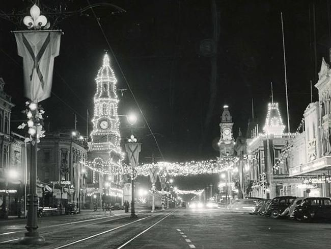 The Adelaide Town Hall clock is lit up in King William St. Picture: National Trust