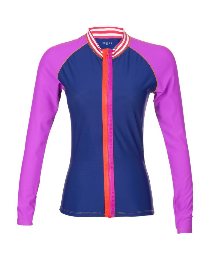 Xirena Boardwalk Rashguard - You can either use this colorful Xirena rash-guard for its intended use at the beach – but can actually see this styled with a pair of shorts for running errands around town. Either way, the colorful patchwork will help you stand out all season long. Try it with the matching Boardwalk Patchwork Bikini.