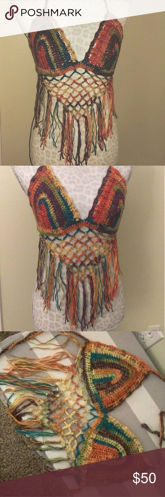 Crochet festival bikini top Handmade crochet bikini top, perfect for this summer's music festivals! To make this, I used a bikini top in a size medium as a reference for the cups. The top and sides tie and the cups stretch as well, so I believe this will fit a range of sizes. Any questions, just ask! Tops