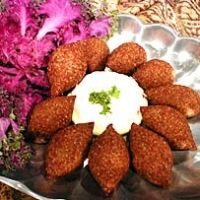 Simple Kibbeh Recipe - little meat footballs of beef or lamb with bulgar wheat. Lebanese dish. This link has step-by-step how to make instructions.. yum!