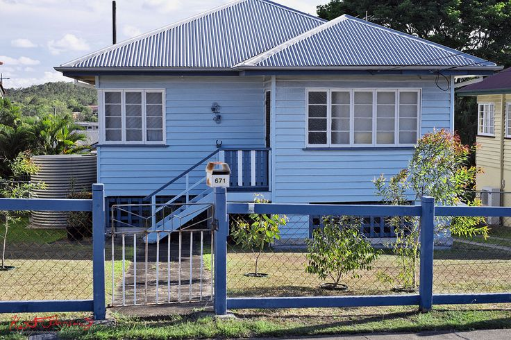I don't really remember seeing such colourful colours on the houses of Carina & Camp Hill but I am sure they were always there. Such nice personal touches. Classic post & rail with wire in-fill fence. Late 40's? Interesting lattice instead of slats  and the weatherboards going down to ground level under the front room.  RAW Developed - RAW File Converter EX Finished in Photoshop..   Fujifilm X-Pro1 - XF35mmF1.4 R 250th at F3.2 200iso  More homes in my Brisbane set here, www.fl...