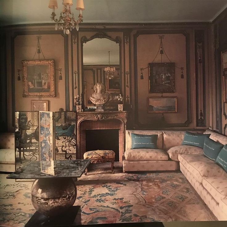 A favorite view of Elsie de Wolfe's Villa Trianon with Pierre Legrain's verre eglomise table in the foreground