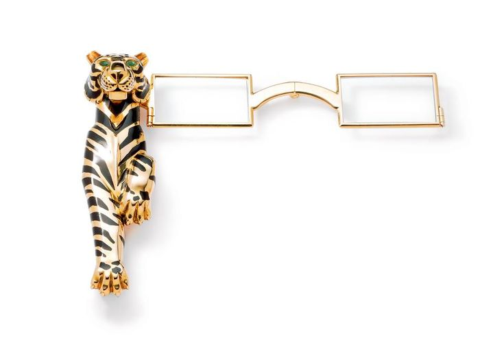 Tigre lorgnette, Cartier Paris, specially ordered in 1954. Gold, striped with black champlevé enamel, set with emeralds. The hinged lorgnett...