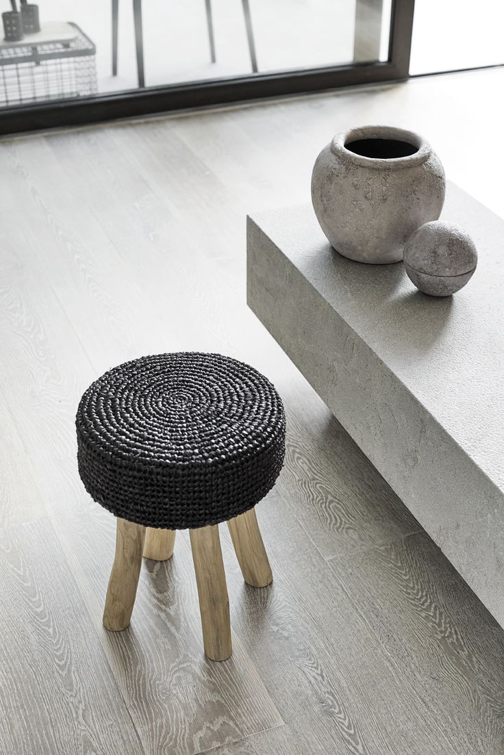 Gajih stool from Muubs made of teak and rice straw. The stool is handmade by skilled artisans in Indonesia. Use the stool in the hallway or in any room where you need an extra seat.