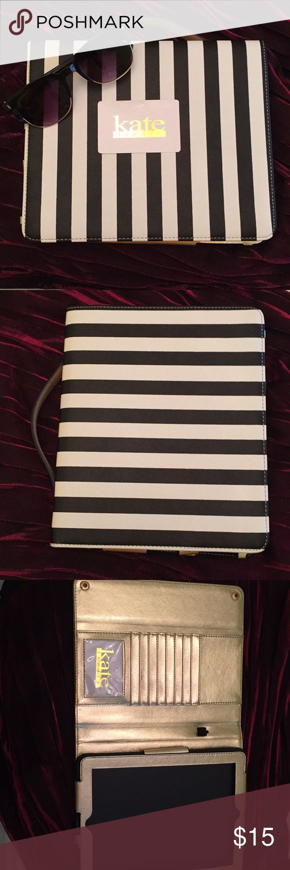 Kate Landry Striped Ipad Case This cute IPad case is both practical and stylish!  It can hold cards and can be carried around by a strap. Holds and Ipad air and can even hold the ipad up into an easel type thing so you can watch movies. Make me a offer!! Kate Landry Accessories Tablet Cases