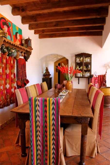 Carole hung these woven fabrics on the backs of the chairs to add color to what are otherwise boring beige chairs!