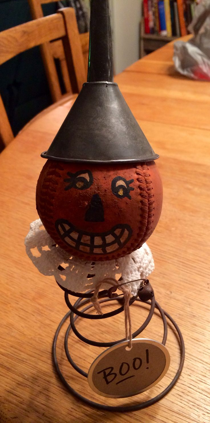 Cute Halloween nodder. Old baseball, rusty bed spring, doily, and tin funnel.