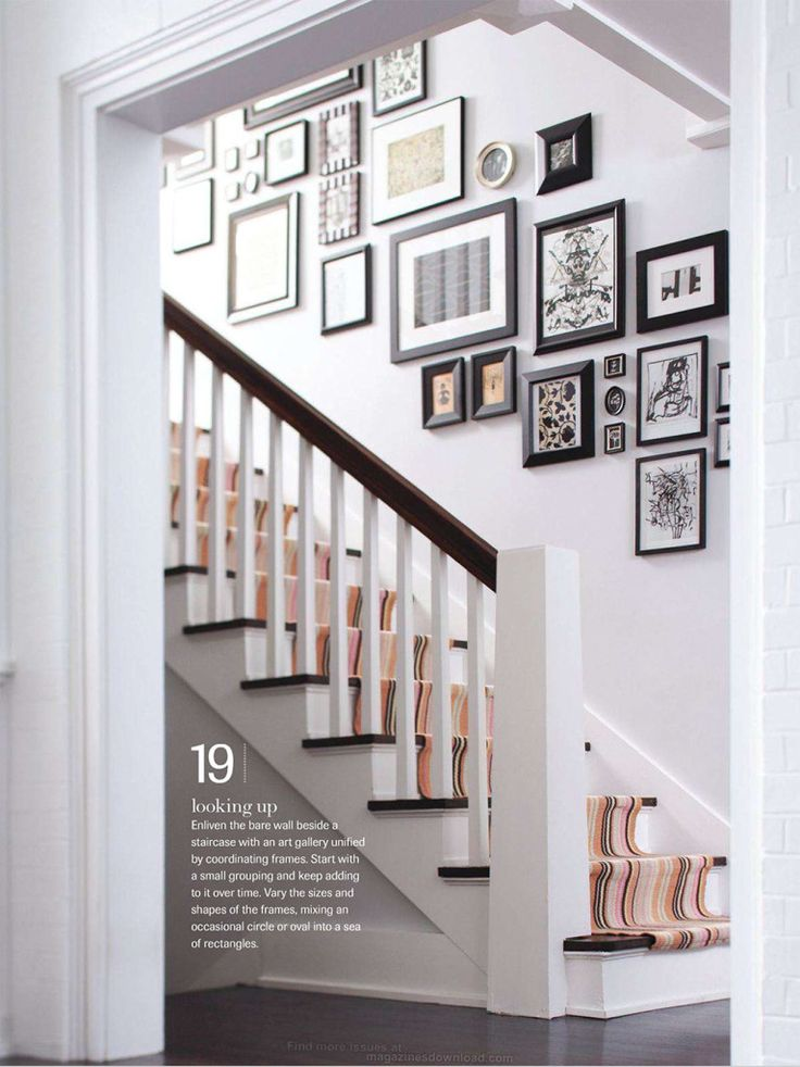 Hallway interior design using Dulux Mellow Mocha, showcasing a picture gallery on the staircase.