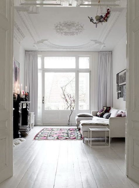 White yet so inviting - love the touch of artisan with the rug and cushions