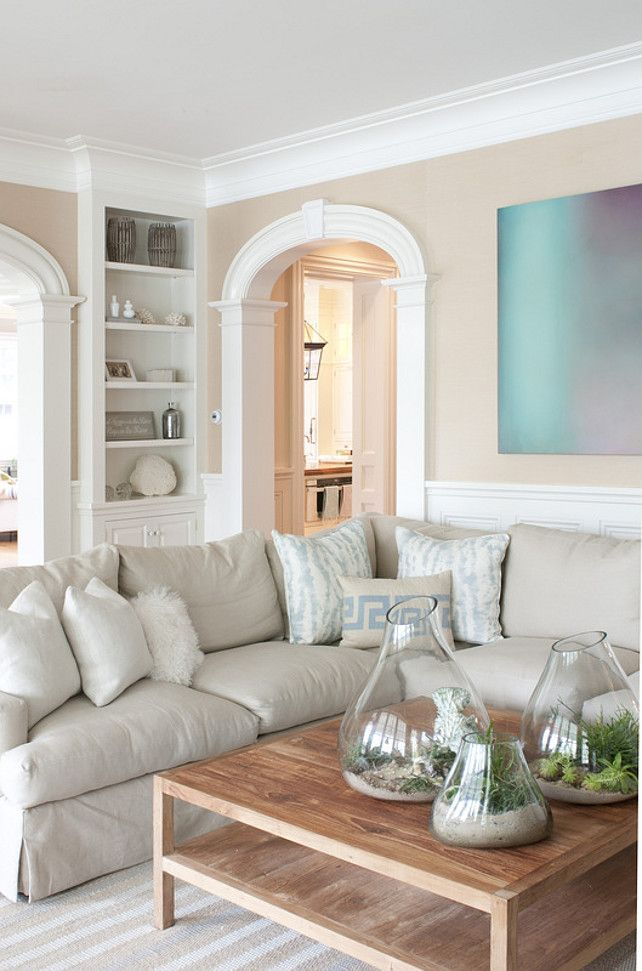 Coastal Family Room. Love the neutrals, the terrariums, and the pop of blue on the wall.