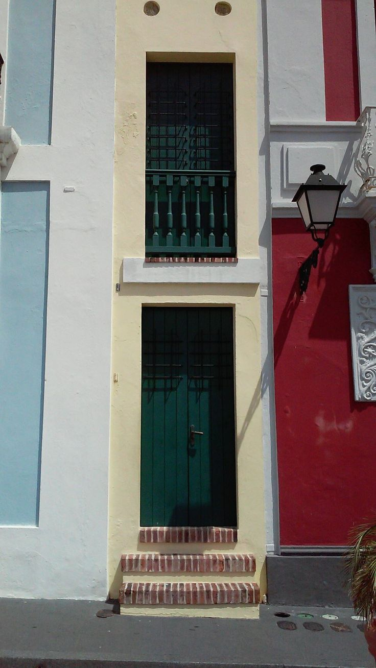 """""""La Casa Estrecha"""": This bright yellow house in Old San Juan is 5 feet throughout and it is one of the narrowest in the world. It stretches 36 feet back and is two stories high. It was formerly a residence, but now the space is currently undergoing renovations."""