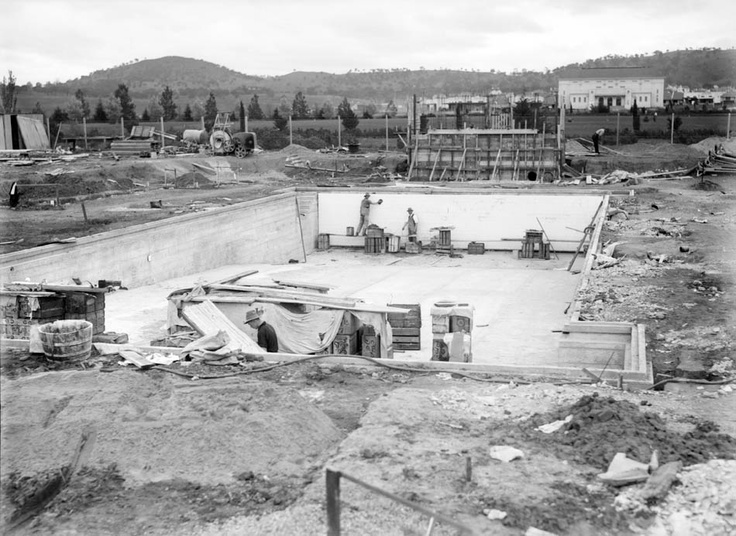 Wall tiles being installed, Manuka Pool, 1930.    Photographer: William James Mildenhall. NAA: A3560, 6454