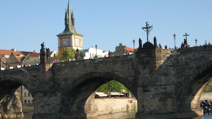 Karlovy bridge. Prague; The Charles Bridge and the Vltava river....