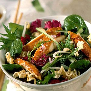 The pineapple-sesame dressing softens the uncooked ramen noodles to give the salad the right amount of crunch.