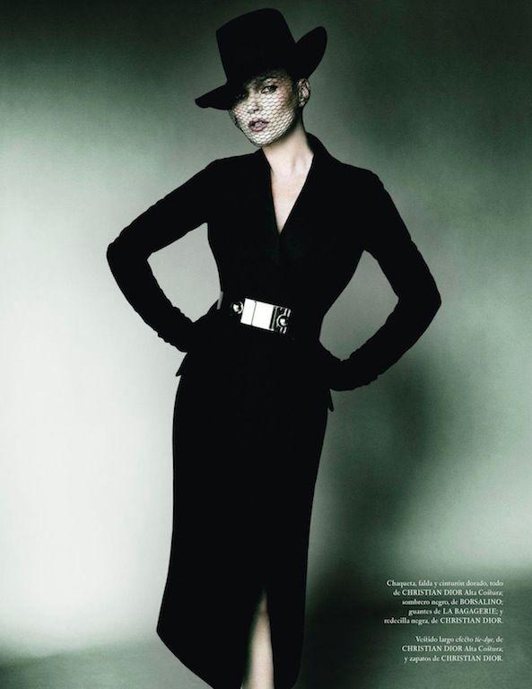 Kate Moss wearing a black Dior dress