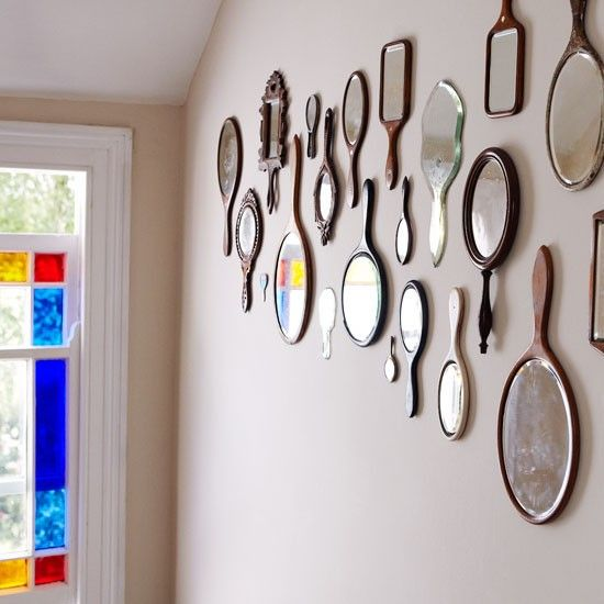 Pretty display of antique and vintage hand mirrors  - would be lovely in a dressing room or vanity area.