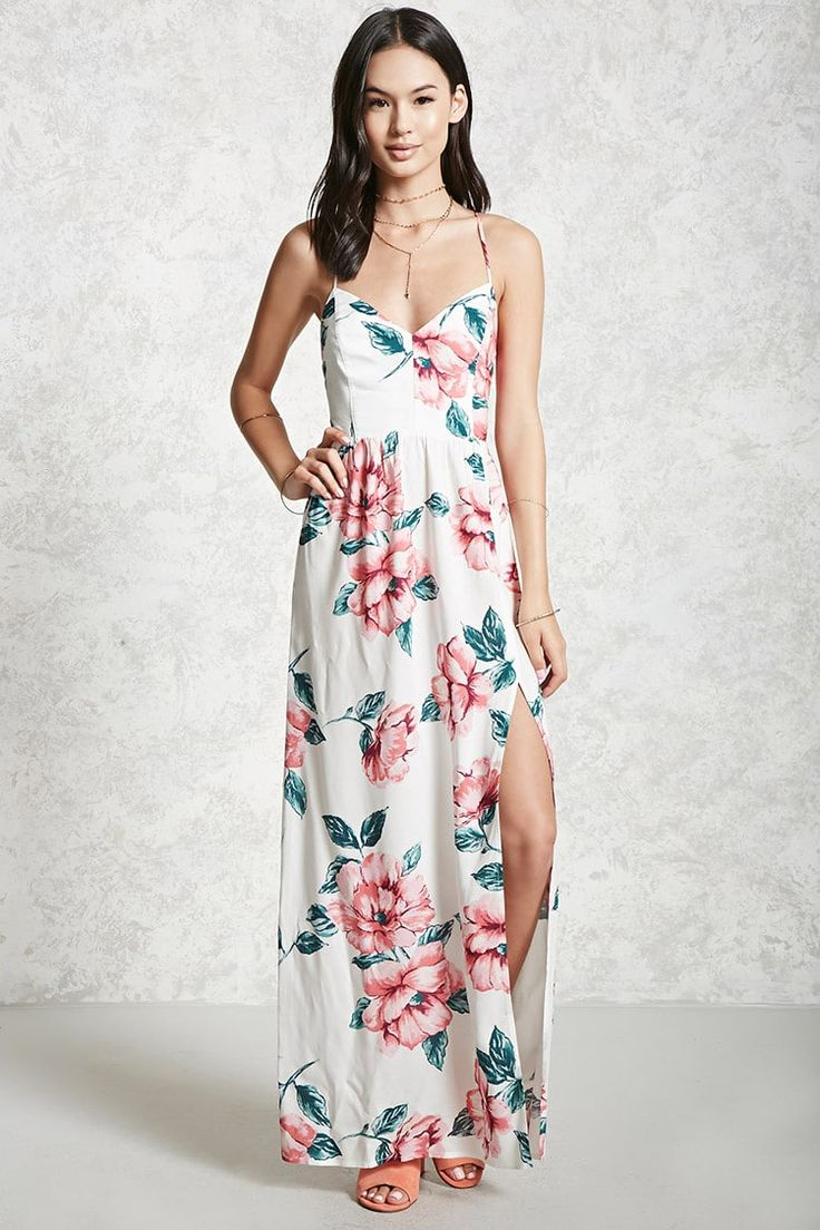 A woven maxi dress featuring an allover floral print, open back with self-tie cami straps that lace-up, a V-neckline, an elasticized back waist, and an asymmetrical front slit.