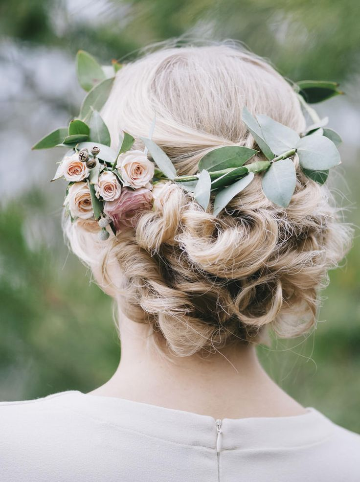 On the subtler side of a full flower crown, this wreath made mostly of greenery looks so delicate and sweet. When paired with an ornately twisted updo, the look ascends to the divine. Hey, goddesses get married, too, right?