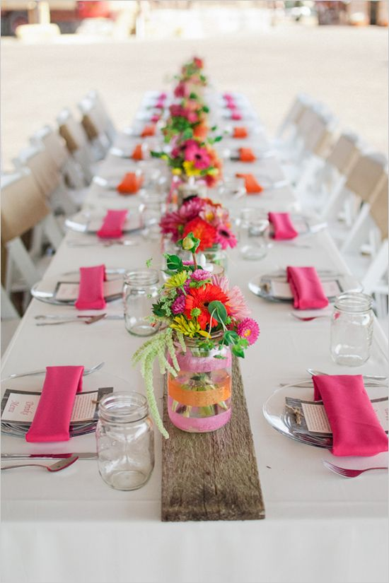 pink and orange wedding decor I love the decorated mason jar vases.