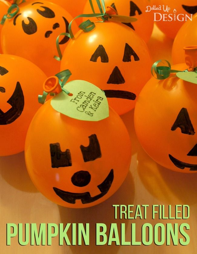 Treat Filled Pumpkin Balloons - an easy DIY Halloween favor idea for kids. Great for a classroom party.