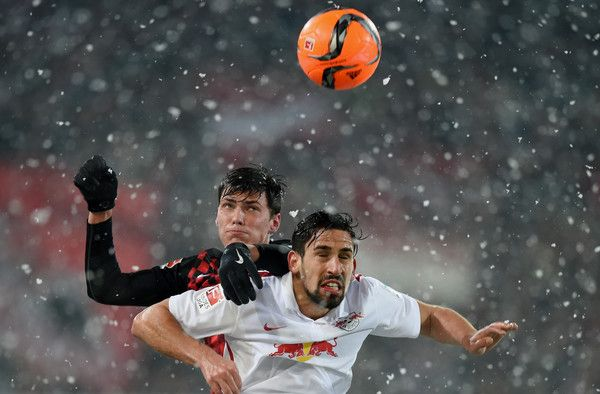 Pascal Stenzel Photos Photos - Pascal Stenzel of Freiburg jumps for a header with Rani Khedira of RB Leipzig during the Second Bundesliga match between SC Freiburg and RB Leipzig at Schwarzwald-Stadion on March 7, 2016 in Freiburg im Breisgau, Germany. - SC Freiburg v RB Leipzig  - 2. Bundesliga
