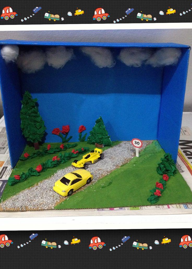 Geschenk zum Führerschein - habe Pappkarton mit Farbe bestrichen - Straße mit Kartenstreu beklebt und Natur aus Krepppapier geformt -zum Schluss die Wolken aus Pappe angeklebt