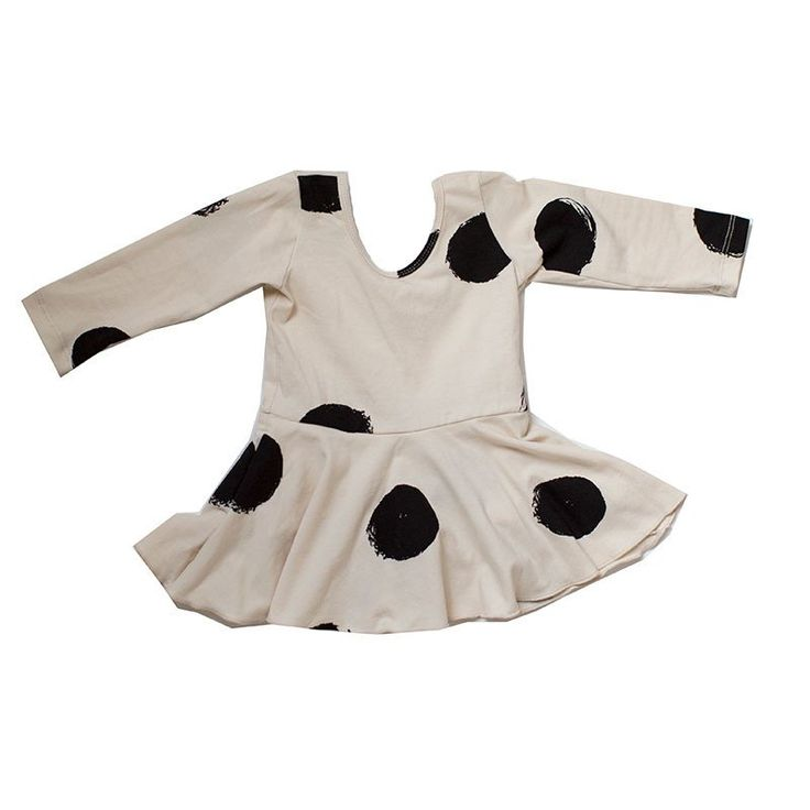 The perfect play leotard with an attached twirly skirt for your tiny ballerina. 95% cotton 5% lycramade in usa  Textiledesign byShanna Kesler.