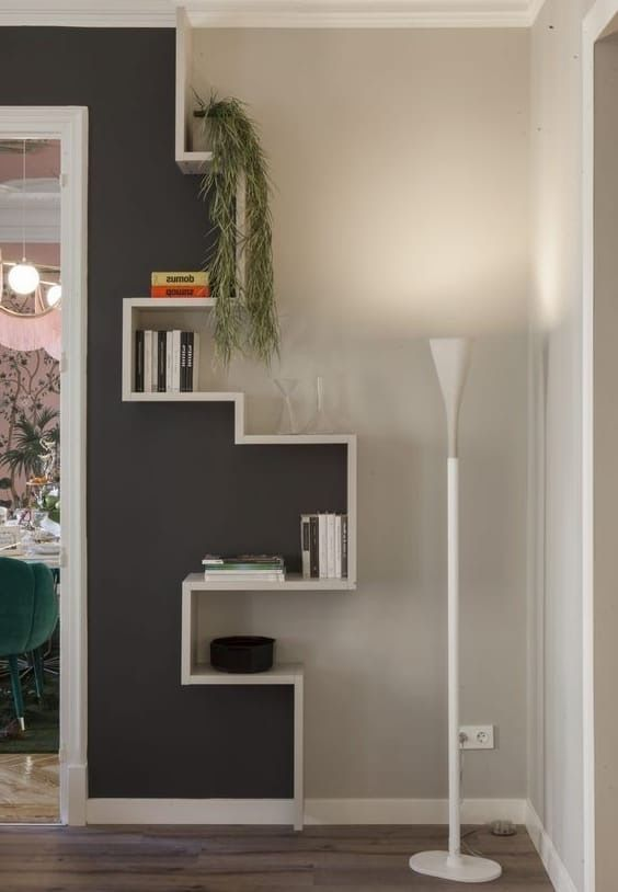 Bookshelves dividing the wall. Perfect for breakin…