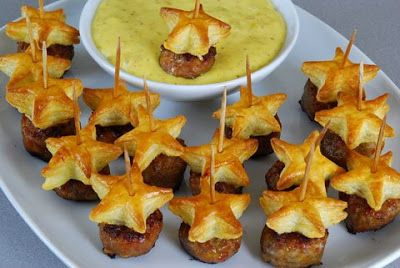 Posh Piggies....These little bites will be a hit at any New Years Eve party Puff pastry & sausage could not be any easier.