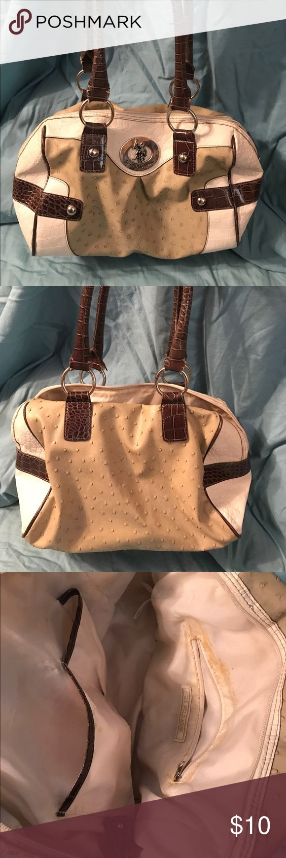 U.S. Polo Assn. Handbag This handbag has been used quite a bit but still has live in it. Bought with the blemishes on the outside and shows use on the inside. Please ask if you have any questions! Thanks for looking! U.S. Polo Assn. Bags Satchels