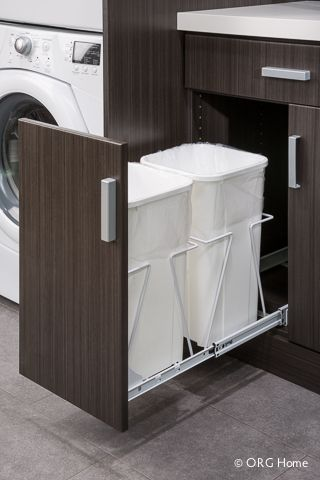 Pull-out recycling and trash bin A hidden bin features wire supports that hold recycling and waste containers securely out of sight. Heavy-duty ball bearing slides help the drawer move smoothly, even when containers are full.