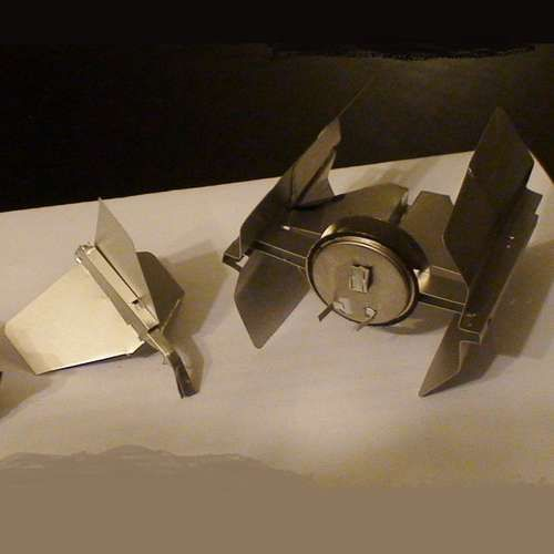 """Looks like I'm going to need to find that old box of floppies I've been keeping """"just in case""""... (TIE Fighter made from floppies - full instructions)"""