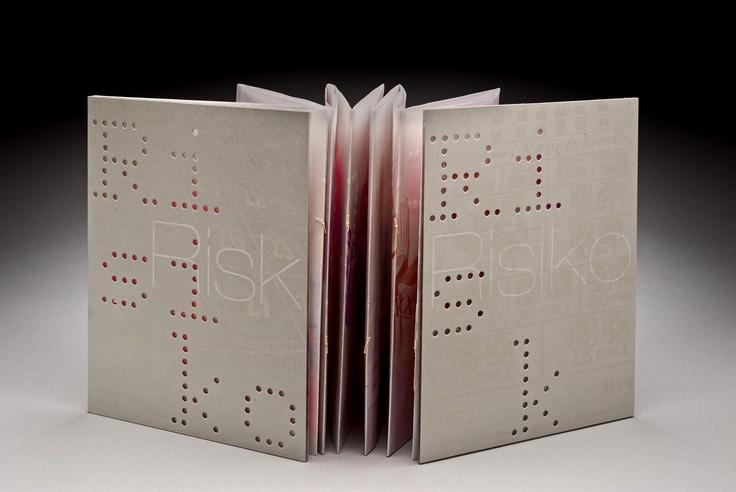Daniela Deeg and Cynthia Lollis, ETC Press (Schwaikheim, Germany)    Risk/Risiko  Double-sided accordion with hard cover, silkscreen printed. Römerturm Cristalla, Römerturm Mohair, clear plastic sheeting, bookboard. 25 pp. Edition of 14.  47 x 30 cm (open); 23.5 x 30 x 3.5 cm (closed)