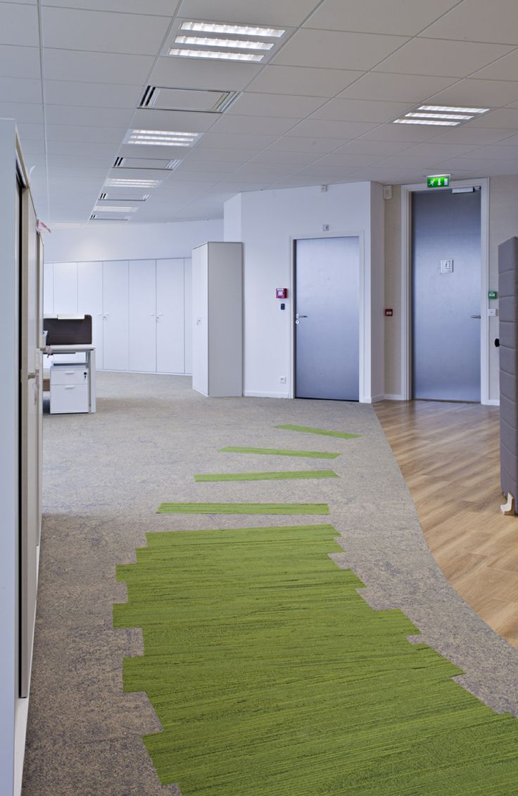 Amazing use of Interface Skinny Planks. A natural, bright office environment.
