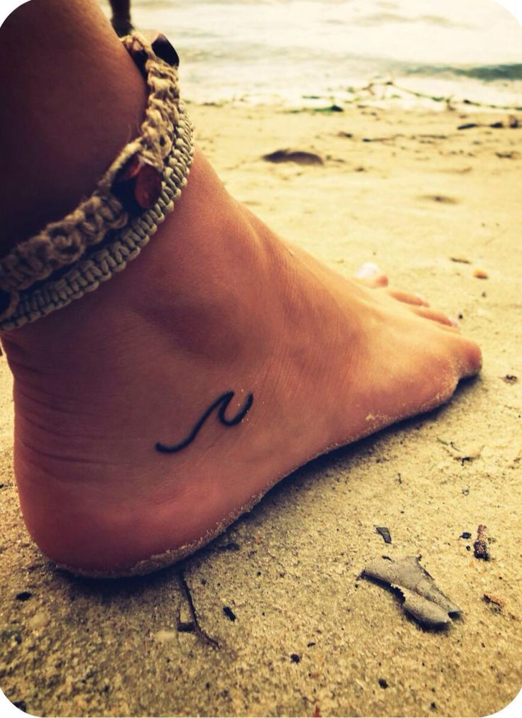 "Small foot tattoo. Little wave. ""I preferred to look at the sea, which said nothing and never made you feel alone."""