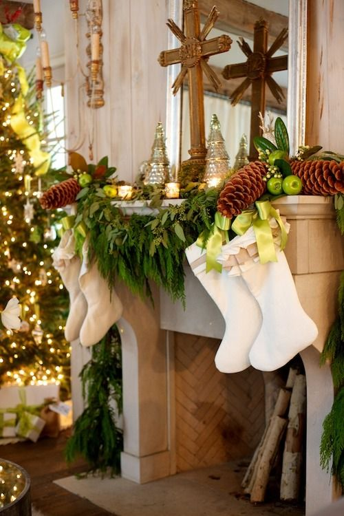 white stockings hung with evergreens, green apples and pine cones: